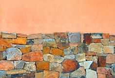 Hintergrund Adobe und Steinwand Stockfoto