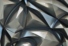 Hintergrund als abstrakte Pyramiden gemacht vom Metall Stockbild
