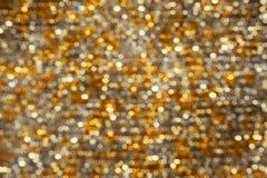 Hintergrund beleuchtet Bokeh abstraktes Goldsilber Stockbilder