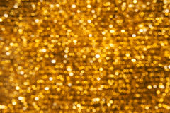 Hintergrund beleuchtet Bokeh Gold Lizenzfreie Stockbilder