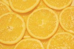 Hintergrund-Beschaffenheit mit orange Scheibe Stockfoto