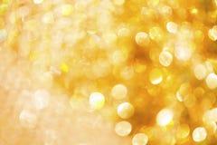 Hintergrund bokeh des strahlenden Golds, Stockbilder