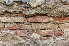 Hintergrund der alten Backsteinmauerbeschaffenheit des Sprunges Stockfoto