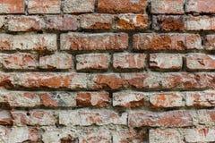 Hintergrund der alten Backsteinmauerbeschaffenheit des Sprunges Stockbild