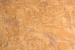 Hintergrund der beige Zementwand ist raue Art des Gipses Stockbilder