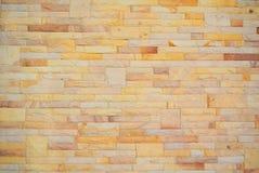 Hintergrund der bunten Backsteinmauer Stockbild