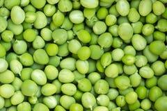Hintergrund der grünen Erbse Stockfoto