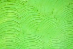 Hintergrund der grünen Zementwand ist die raue Gipskurve Lizenzfreies Stockfoto