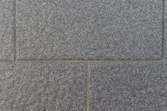 Hintergrund der grauen Backsteinmauer Stockfotografie