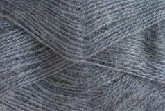 Hintergrund der grauen Wolle Garnmohair Stockfotos