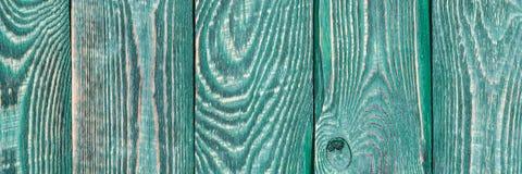 Hintergrund der hölzernen Beschaffenheit verschalt mit einem Rest Farbe der grünen Farbe vertikal natalia stockfoto