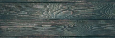 Hintergrund der hölzernen Beschaffenheit verschalt mit Resten der dunkelgrünen Farbe natalia stockfoto