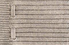 Hintergrund der handgemachten Maschenware der Wollecremefarbe, Stoff strickte Beschaffenheit lizenzfreies stockbild