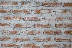Hintergrund der schmutzigen Backsteinmauer der alten Weinlese mit Schalengips, Stockfotos