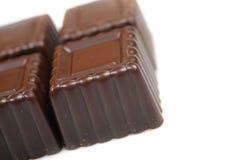 Hintergrund der Schweizer dunklen Schokoladen Stockfotos