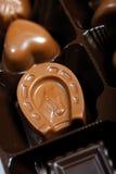 Hintergrund der Schweizer dunklen Schokoladen Stockbilder