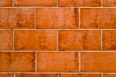 Hintergrund der Terrakottaziegelsteine Stockbild