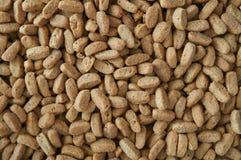 Hintergrund der trockenen Nahrung für Katzen Lizenzfreies Stockfoto