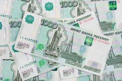 Hintergrund der zerstreuten Bezeichnung des russischen Rubels der Banknoten tausend Rubel Lizenzfreie Stockfotografie
