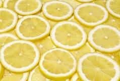 Hintergrund der Zitrone schneidet Nahaufnahme Stockbild