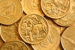 Hintergrund des Australiers ein Dollar-Münzen Stockfoto