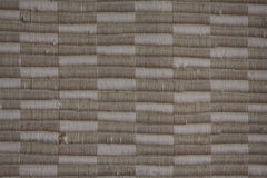 Hintergrund des gesponnenen beige und tan Gewebes Stockfoto