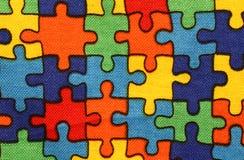Hintergrund des Gewebes mit Stücken des Puzzlespiels Stockbild