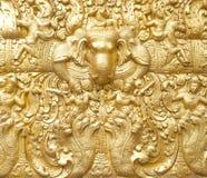 Hintergrund des goldenen Elefanten im Buddhismus Stockfotos