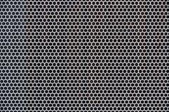Hintergrund des grauen Metalls mit Löchern Stockbild