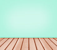 Hintergrund des Holzfußbodens und der Wand des blauen Grüns Stockfoto
