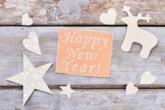 Hintergrund des neuen Jahres mit Papierdekorationen Lizenzfreies Stockbild