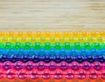 Hintergrund des Regenbogengeleestockes für LGBT-Konzept Lizenzfreie Stockfotos