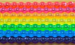 Hintergrund des Regenbogengeleestockes für LGBT-Konzept Lizenzfreies Stockbild