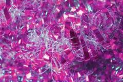 Hintergrund des rosa und weißen Lamettas Lizenzfreies Stockfoto