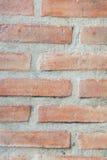 Hintergrund des roten Backsteins und der Betonmauer Stockfotografie
