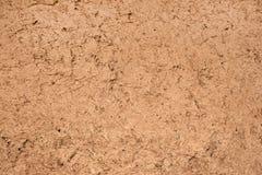 Hintergrund des roten Lehms Lizenzfreie Stockfotografie