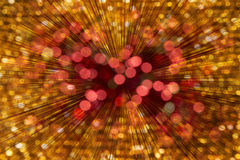 Hintergrund-dynamische Leuchten Bokeh rotes Goldenes Lizenzfreies Stockfoto
