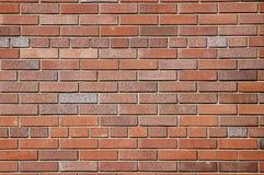 Hintergrund einer Backsteinmauer. Lizenzfreies Stockfoto