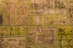 Hintergrund eines alten getragenen Teppichs Stockfotos