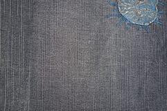 Hintergrund eines Denimgewebes der grauen Farbe Stockbild