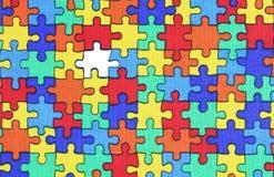 Hintergrund eines Puzzlespiels mit einem fehlenden Stück Lizenzfreie Stockfotografie