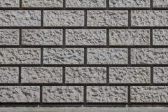 Hintergrund - errichtendes Äußeres mit einem Maurerarbeit-Muster Lizenzfreie Stockbilder