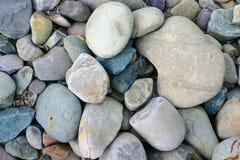 Hintergrund-Fluss-Felsen Stockfoto