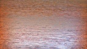 Hintergrund, glatte hölzerne Beschaffenheit, Baumstamm, Brauntöne, einfache hölzerne Fläche, vorherrschende braune Farbe Stockfoto