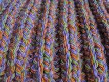 Hintergrund handgemachtes Knitmuster in Mehrfarben Lizenzfreie Stockfotos