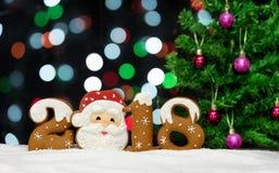 Hintergrund 2018, Lichtgirlanden, bokeh des neuen Jahres Lizenzfreies Stockbild