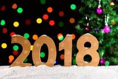 Hintergrund 2018, Lichtgirlanden, bokeh des neuen Jahres Lizenzfreies Stockfoto