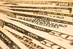 Hintergrund mit amerikanischen Dollarscheinen des Geldes Stockbild
