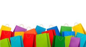 Hintergrund mit bunten Einkaufstaschen. Rabatt c Lizenzfreie Stockfotos