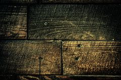 Hintergrund mit der alten hölzernen Planke verziert mit rostigen Nägeln stockbild